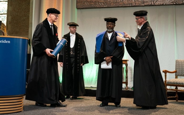 Professor Lungisile Ntsebeza receives his honorary doctorate from honorary supervisor Jan-Bart Gewald.